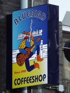 Big sign for Bluebird Coffeeshop near Nieumarkt in Amsterdam