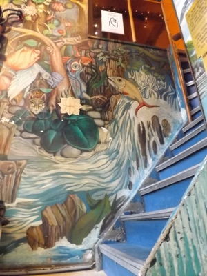 Jungle mural going upstairs at Bluebird Coffeeshop in Amsterdam