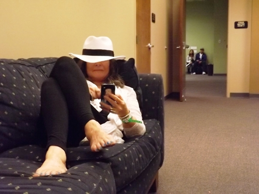Woman in hat on couch at Denver Cannabis Cup