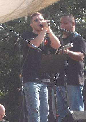 Russ Hudson performing at a benefit concert
