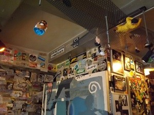 Toys on the ceiling at Grey Atea coffeeshop
