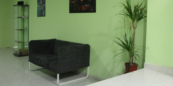 Couch and shelf at Los Secretos de Maria Madrid Cannabis Club