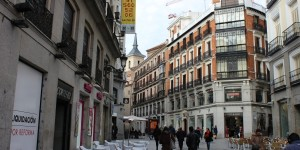 Street with Church tower sticking out in Madrid Spain