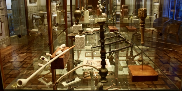 Display case of cannabis pipes at the Hash Museum BCN