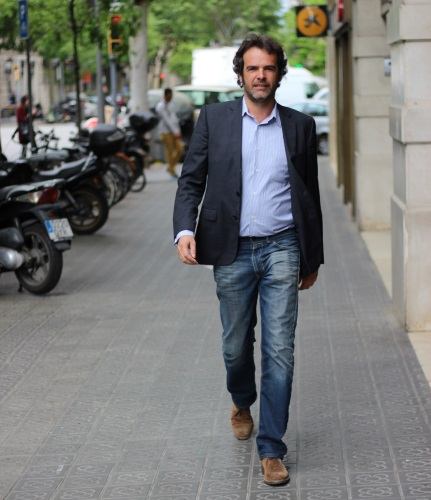 Oriol Casals Madrid walking on Calle Casp in Barcelona