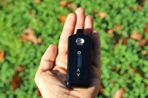 E-Clipse Vape in hand green background front view