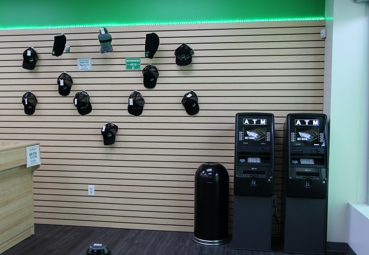 Hats and an ATM at Green Dragon on Colfax