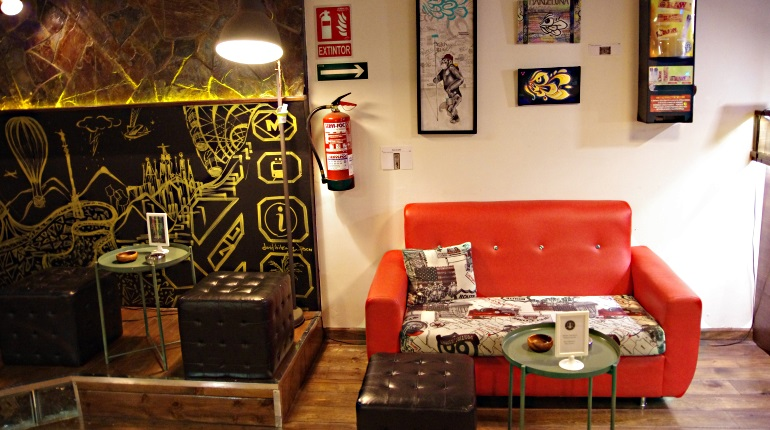 Red couch at Stargrass weed club Barcelona