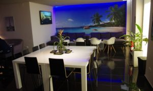 Beach scene and tables at Zanzi cannabis club Barcelona Spain