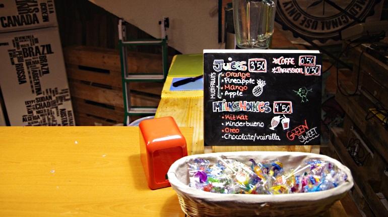 Juice menu and candies at Green Shot cannabis club Madrid