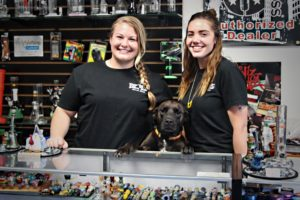 Destioney and puppy and partner at Rip Tide Head Shop in Belfast Maine