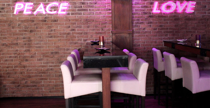 High tables with and pink neon lights