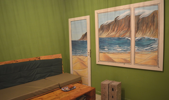 One of the walls inside Green In Door has a painting of Famara