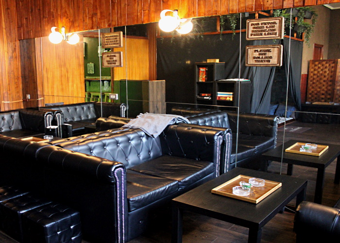 One of the many chill out areas of Culcanna, decorated with leather sofas and a big mirror