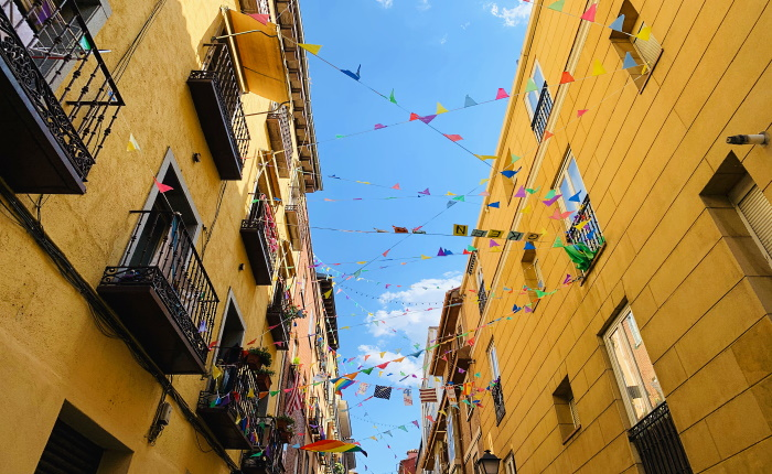 If you look up strolling around Malasaña you'll find all the streets decorated